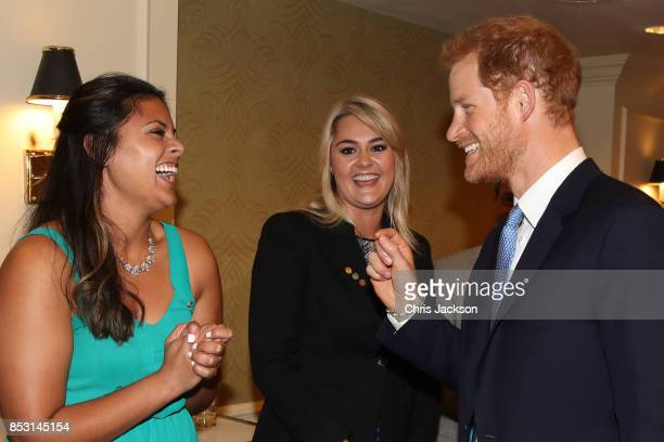 Prince Harry greets The Duke Edinburgh's International Gold Award winners Jessica Silva and Augusta White during Day 2 of the Invictus Games 2017 at...