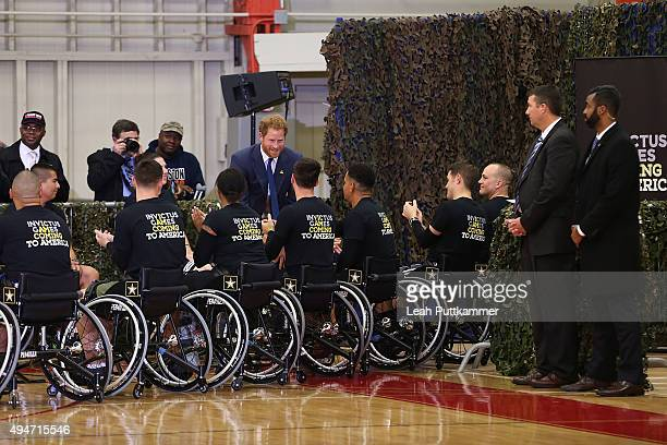 Prince Harry greets Wounded Warriors basketball players at the Joining Forces Invictus Games Event at Wells Field House on October 28 2015 in Fort...