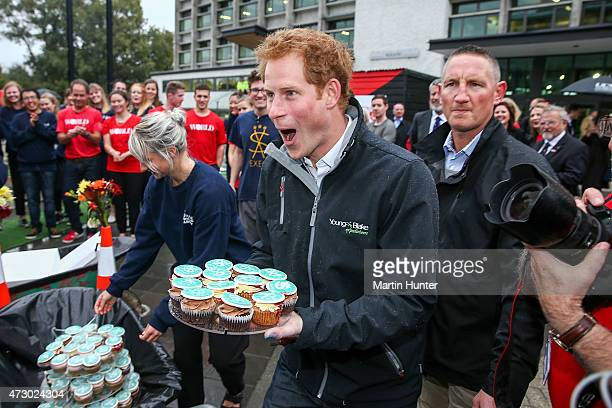 Prince Harry hands out cup cakes during a visit to University of Canterbury Student Volunteer Army on May 12 2015 in Christchurch New Zealand Prince...
