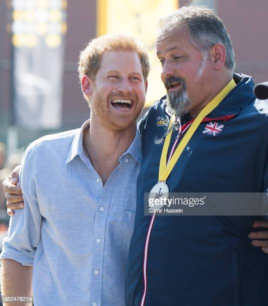 Prince Harry hands out medals as he attends the Jaguar Land Rover Driving Challenge on day 1 of the Invictus Games Toronto 2017 on September 23 2017...