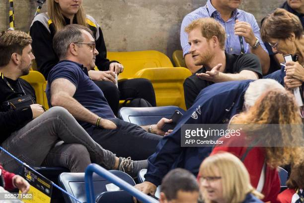 Prince Harry has a conversation during a break in the action at the wheelchair rugby match between the United States and Denmark at the Invictus...