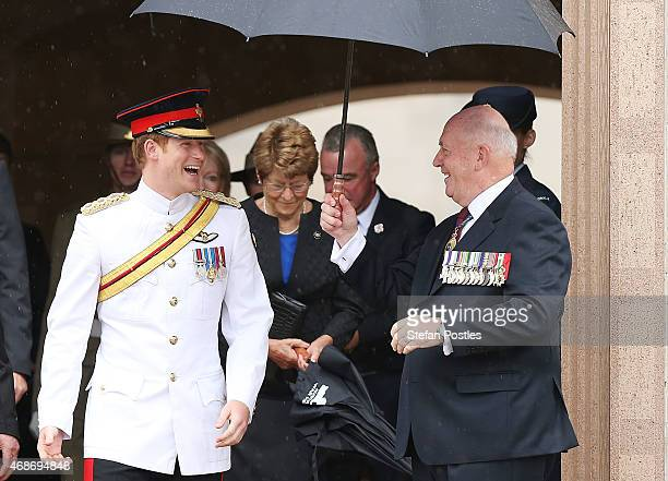 Prince Harry has a laugh with Governor General Peter Cosgrove at the Australian War Memorial on April 6 2015 in Canberra Australia Prince Harry or...