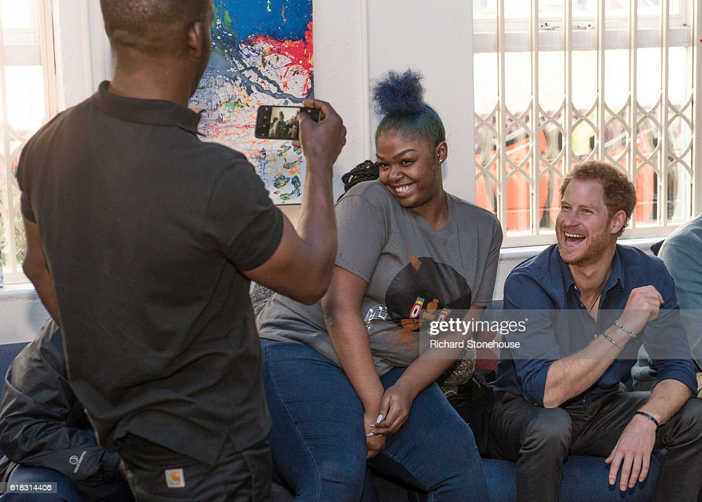 Prince Harry has a photo taken with 16 year old Renee Hines in one of the rehersal studios while watching a performance of a play during his visit the Community Recording Studio at Russell Youth Centre on October 26, 2016 in Nottingham, United Kingdom. The Royal Foundation is working with Epic Partners and the Community Recording Studio (CRS) to deliver Full Effect: a project to improve the opportunities for young people and reduce youth violence in St. Ann's, Nottingham.