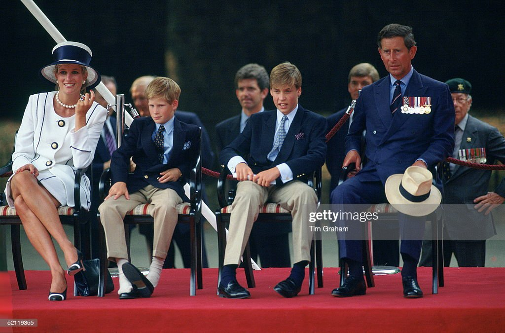 Prince Harry Has Kicked Off His Shoes Whilst Watching The Vj Day 50th Anniversary Parade. He Is Sitting With His Family - Diana, Princess Of Wales, Prince Charles And Prince William.