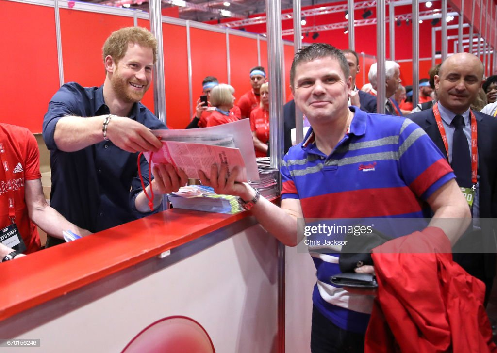 Prince Harry helps staff and meets runners as he officially opens the Virgin Money London Marathon Expo at ExCel on April 19, 2017 in London, England. Prince Harry, who is Patron of the London Marathon Charitable Trust, will hand out race numbers, along with special edition 'Heads Together' headbands, which is the official Charity of the Year for this year's marathon.