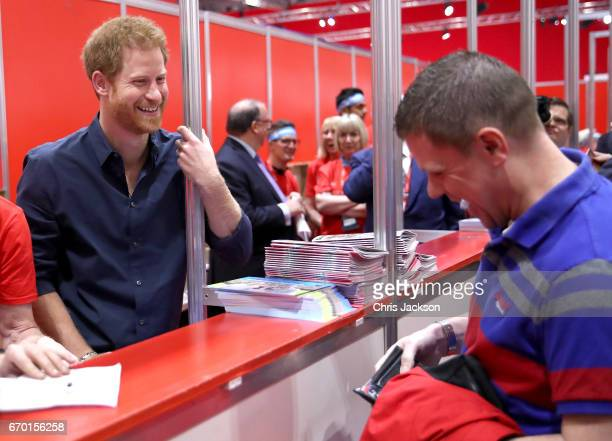 Prince Harry helps staff and meets runners as he officially opens the Virgin Money London Marathon Expo at ExCel on April 19 2017 in London England...