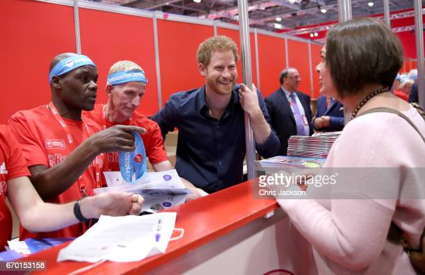 Prince Harry helps staff as he officially opens the Virgin Money London Marathon Expo at ExCel on April 19 2017 in London England Prince Harry who is...