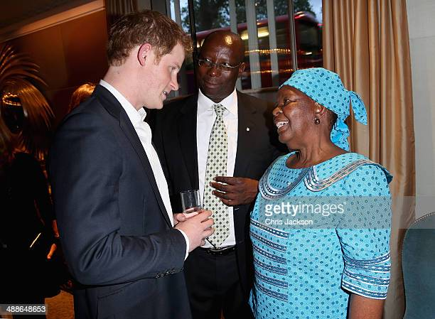 Prince Harry Herd Boy coordinator Mokhachane Lerotholi and Malineo Motsephe attend the Sentebale Summer Party at the Dorchester Hotel on May 7 2014...
