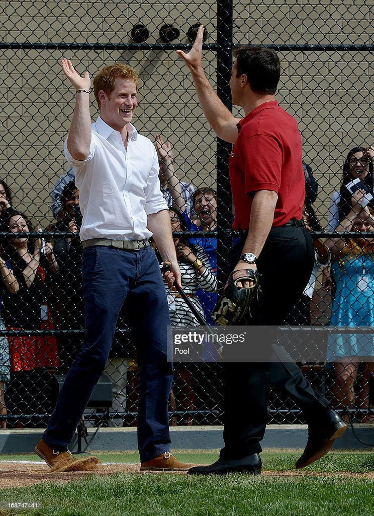 <a gi-track='captionPersonalityLinkClicked' href=/galleries/search?phrase=Prince+Harry&family=editorial&specificpeople=178173 ng-click='$event.stopPropagation()'>Prince Harry</a> (L) high fives New York Yankees baseball player Mark Texeria while participating in a baseball clinic during the launch of a new partnership between the Royal Foundation of the Duke and Duchess of Cambridge and Harlem RBI, a local community organization May 14, 2013 in the Harlem neighborhood of New York City. HRH will be undertaking engagements on behalf of charities with which the Prince is closely associated on behalf also of HM Government, with a central theme of supporting injured service personnel from the UK and US forces.