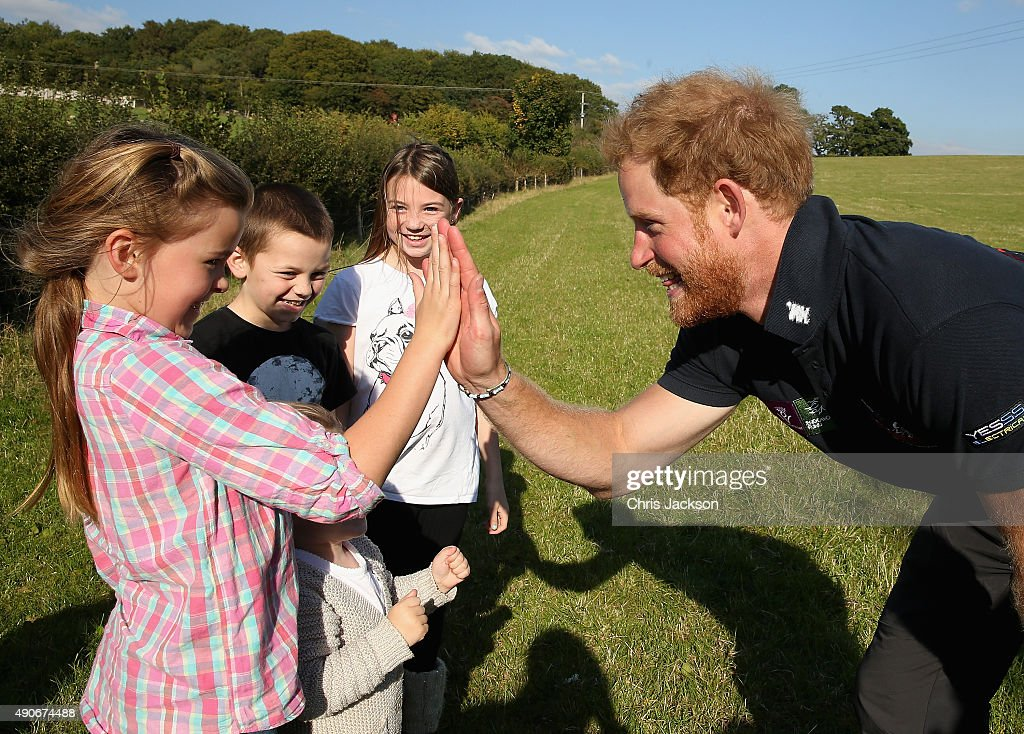 Prince Harry high-fives a young girl as he walks the route to Ludlow with Walking with the Wounded's Walk of Britain team on September 30, 2015 in Ludlow, England. Prince Harry is patron of the expedition and walked today as part of the veteran's 1000 mile, 72 day expedition through the UK mainland.