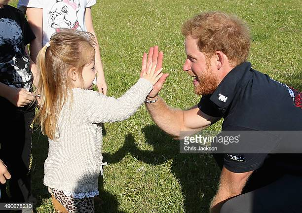 Prince Harry highfives a young girl as he walks the route to Ludlow with Walking with the Wounded's Walk of Britain team on September 30 2015 in...