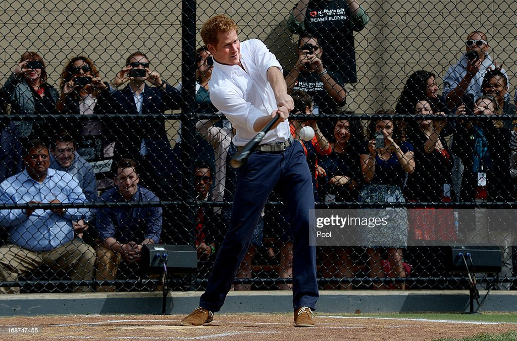 <a gi-track='captionPersonalityLinkClicked' href=/galleries/search?phrase=Prince+Harry&family=editorial&specificpeople=178173 ng-click='$event.stopPropagation()'>Prince Harry</a> hits a baseball while participating in a baseball clinic during the launch of a new partnership between the Royal Foundation of the Duke and Duchess of Cambridge and Harlem RBI, a local community organization May 14, 2013 in the Harlem neighborhood of New York City. HRH will be undertaking engagements on behalf of charities with which the Prince is closely associated on behalf also of HM Government, with a central theme of supporting injured service personnel from the UK and US forces.