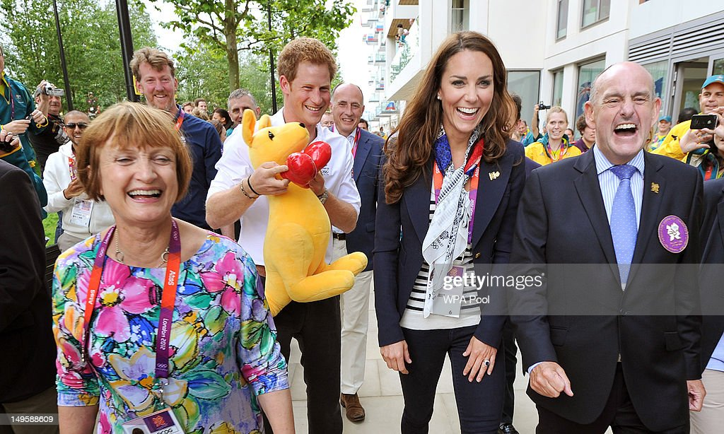 Prince Harry holds a Kangaroo given to him by Australian athletes as he walks with Catherine Duchess of Cambridge MP Tessa Jowell and Mayor of the...