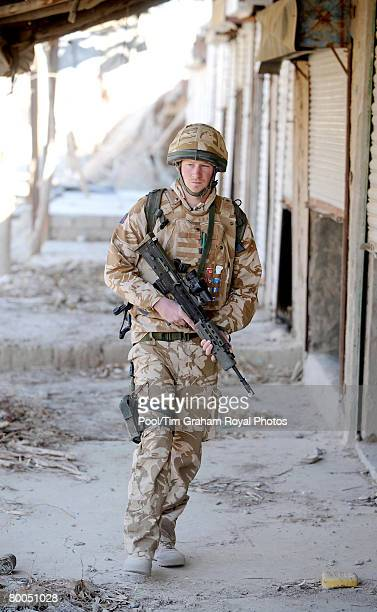 Prince Harry holds an SLR rifle on patrol through the deserted town of Garmisir close to FOB Delhi where he was posted in Helmand province on January...