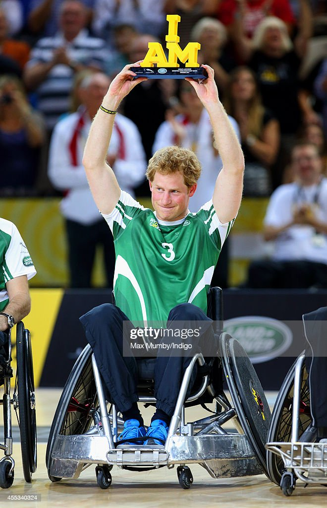 Prince Harry holds the 'I am' trophy aloft after winning a Wheelchair Rugby exhibition match in the Copper Box Arena during the Invictus Games on...
