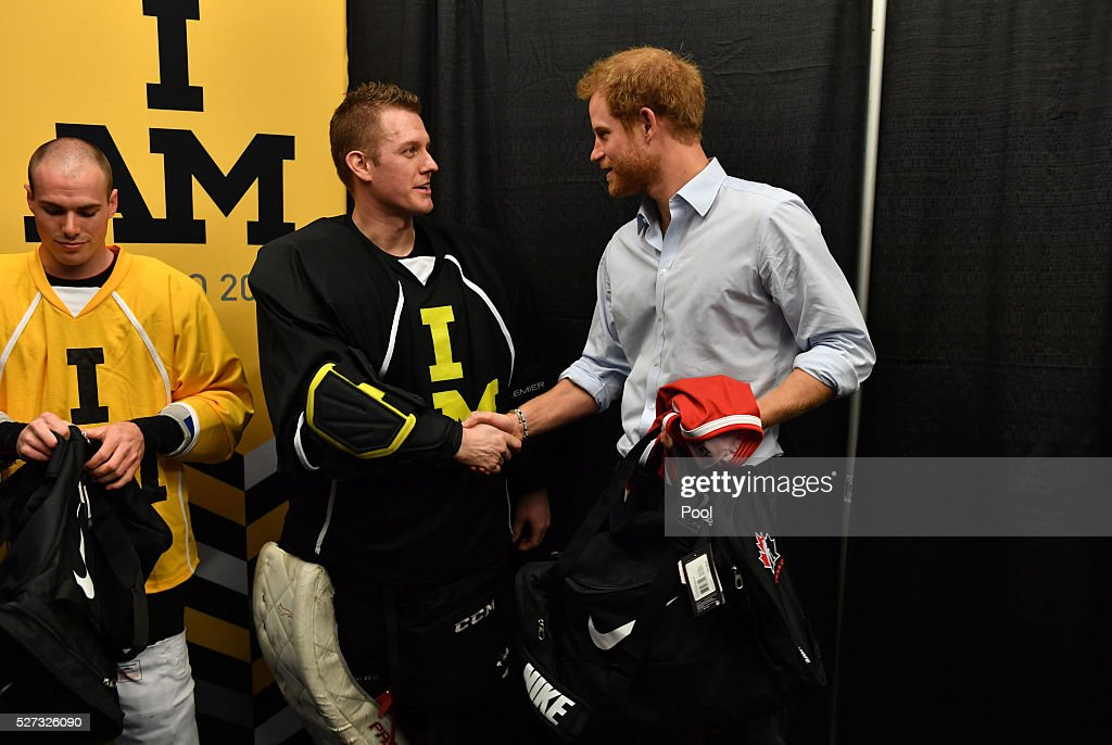 Prince Harry holds the #17 Wales hockey jersey up as he meets with Invictus Games athletes after a sledge-hockey match Mattany at the Athletic Centre on May 2, 2016 in Toronto, Canada. Prince Harry is in Toronto for the Launch of the 2017 Toronto Invictus Games before heading down to Miami and the 2016 Invictus Games in Orlando.