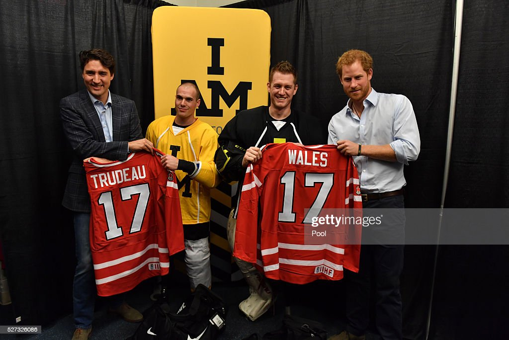 Prince Harry holds the #17 Wales hockey jersey up with Canadian Prime Minister Justin Trudeau as they meet with Invictus Games athletes after a sledge-hockey match Mattany at the Athletic Centre on May 2, 2016 in Toronto, Canada. Prince Harry is in Toronto for the Launch of the 2017 Toronto Invictus Games before heading down to Miami and the 2016 Invictus Games in Orlando.