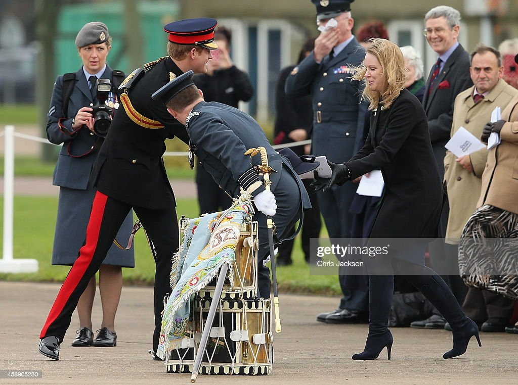 <a gi-track='captionPersonalityLinkClicked' href=/galleries/search?phrase=Prince+Harry&family=editorial&specificpeople=178173 ng-click='$event.stopPropagation()'>Prince Harry</a>, Honorary Air Commandant, picks up a woman's hat the wind blew off as he visits RAF Honington on November 13, 2014 in Bury St Edmunds, England. The Prince visited RAF Honington to present No. 26 Squadron with a new Standard.