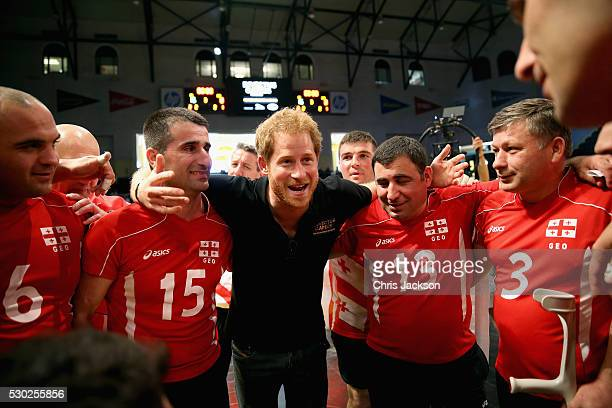 Prince Harry huddles with the Georgia team after they were beaten by the UK Armed Forces Team at sitting volleyball during the Invictus Games Orlando...
