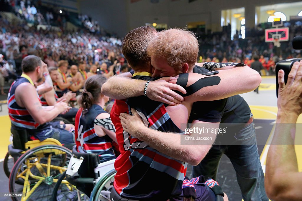 Prince Harry hugs competitors and presents medals during the wheelchair basketball on the final day of the Invictus Games Orlando 2016 at ESPN Wide World of Sports on May 12, 2016 in Orlando, Florida. Prince Harry, patron of the Invictus Games Foundation is in Orlando for the Invictus Games 2016. The Invictus Games is the only International sporting event for wounded, injured and sick servicemen and women. Started in 2014 by Prince Harry the Invictus Games uses the power of Sport to inspire recovery and support rehabilitation.