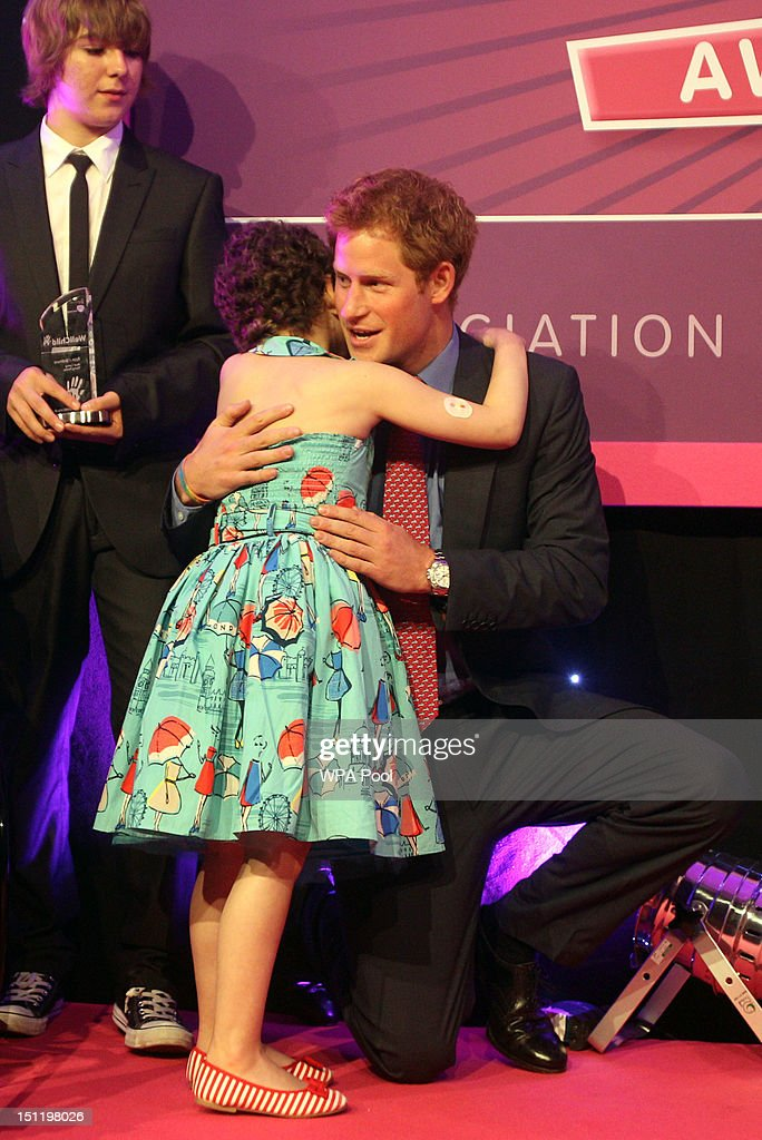 Prince Harry hugs nine years old Rose Whittle at the WellChild Awards at the Intercontinental Hotel on September 3, 2012 in London, England.