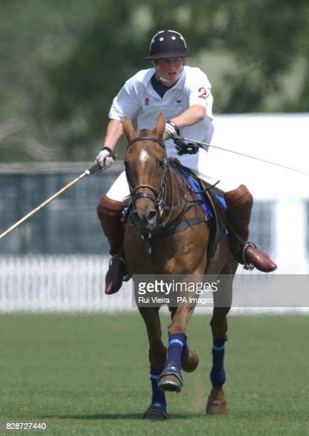 Prince Harry in action against France as he captains the England team at the National Schools Polo Tournament at Dallas Burston Polo Grounds Southam...