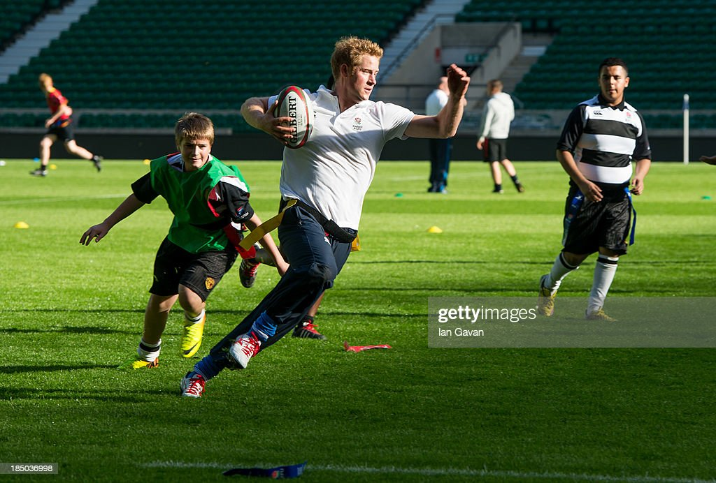 Prince Harry in action during a coaching session during his visit to the RFU All School programme coaching event at Twickenham Stadium on October 17, 2013 in London, England.