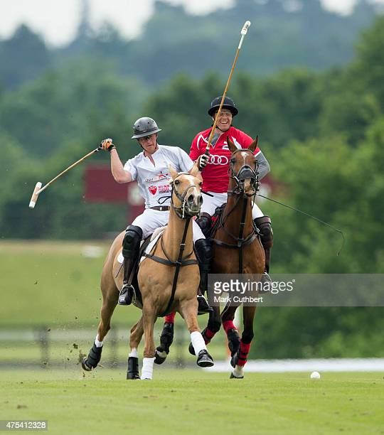 Prince Harry in action during day two of the Audi Polo Challenge at Coworth Park on May 31 2015 in London England