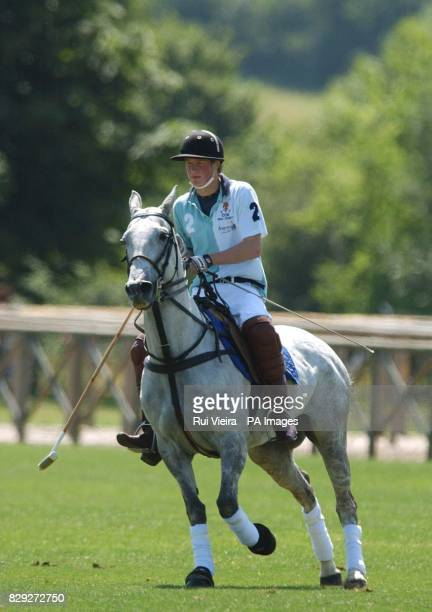 Prince Harry in action for Eton against Marlborough during The National Schools Polo Tournament at Dallas Burston Polo Grounds Southam Warwickshire