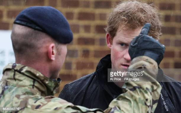 Prince Harry in Datchet Berkshire as he and his brother the Duke of Cambridge joined colleagues from the armed forces in helping to defend the town...