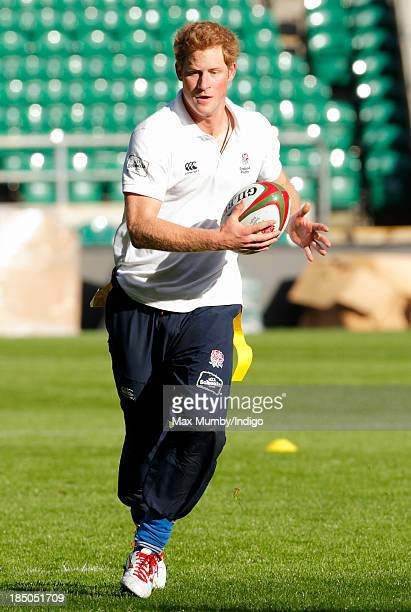 Prince Harry in his role as Patron of the Rugby Football Union All Schools Programme takes part in a rugby coaching session at Twickenham Stadium on...