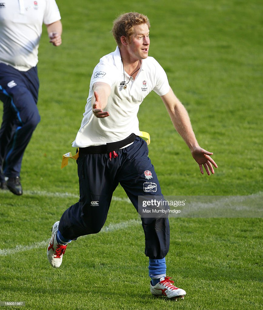 Prince Harry, in his role as Patron of the Rugby Football Union All Schools Programme, takes part in a rugby coaching session at Twickenham Stadium on October 17, 2013 in London, England.
