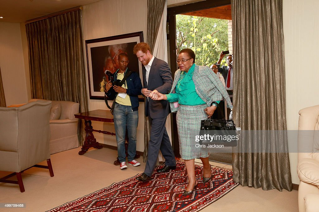 Prince Harry in Nelson Mandela's office with Graca Machel his widow at the Nelson Mandela Foundation Centre of Memory on December 3, 2015 in Johannesburg, South Africa. Prince Harry is visiting South Africa as part of a Royal Tour that has included the Opening of a new Charity Centre for children in Lesotho (Sentebale's Mamohato Children's Centre) and includes stops in Durban, Cape Town, Kruger National Park and Johannesburg.