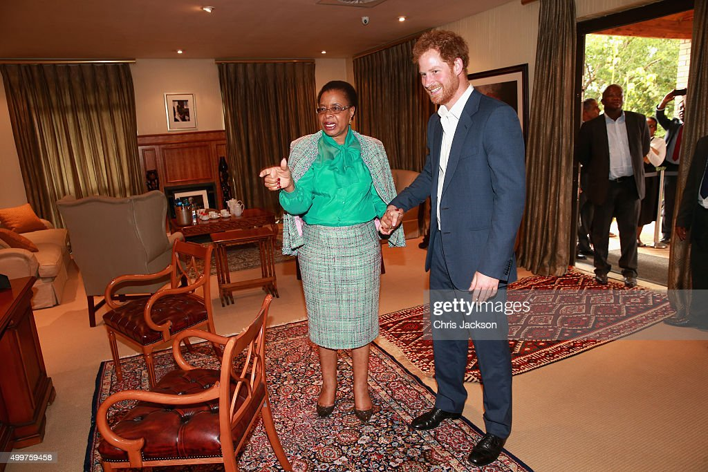 Prince Harry in Nelson Mandela's office with his widow Graca Machel at the Nelson Mandela Foundation Centre of Memory on December 3, 2015 in Johannesburg, South Africa. Prince Harry is visiting South Africa as part of a Royal Tour that has included the Opening of a new Charity Centre for children in Lesotho (Sentebale's Mamohato Children's Centre) and includes stops in Durban, Cape Town, Kruger National Park and Johannesburg.