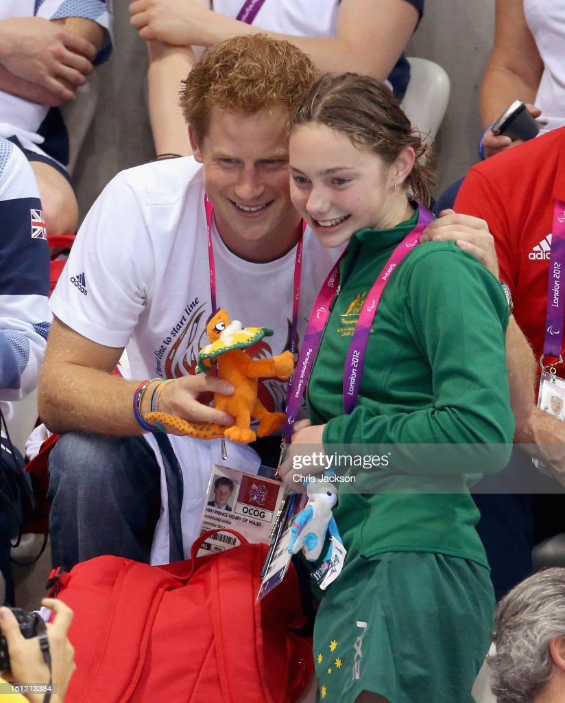 <a gi-track='captionPersonalityLinkClicked' href=/galleries/search?phrase=Prince+Harry&family=editorial&specificpeople=178173 ng-click='$event.stopPropagation()'>Prince Harry</a> is given a mascot by Australian Paralympic swimmer Maddison Elliott on day 6 of the London 2012 Paralympic Games at the Aquatics Centre on September 4, 2012 in London, England.