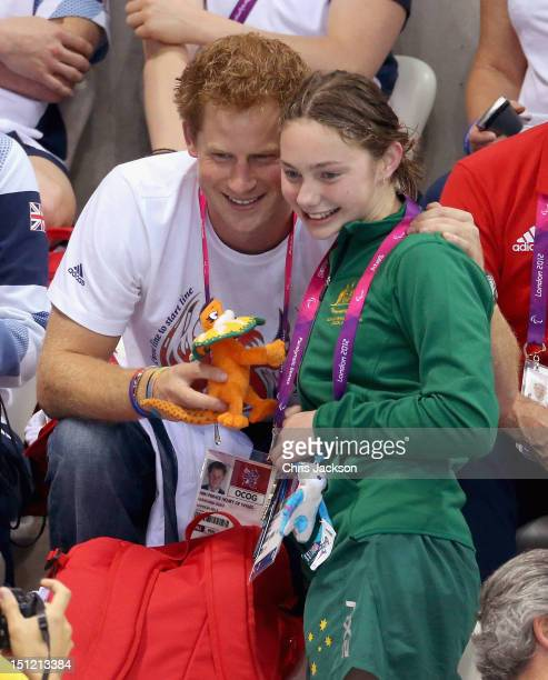 Prince Harry is given a mascot by Australian Paralympic swimmer Maddison Elliott on day 6 of the London 2012 Paralympic Games at the Aquatics Centre...