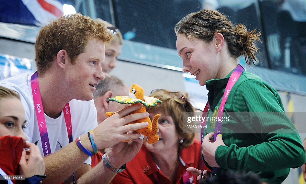 <a gi-track='captionPersonalityLinkClicked' href=/galleries/search?phrase=Prince+Harry&family=editorial&specificpeople=178173 ng-click='$event.stopPropagation()'>Prince Harry</a> is given a mascot from Australian Paralympic swimmer Maddison Elliott on day 6 of the London 2012 Paralympic Games at the Aquatics Centre on September 4, 2012 in London, England.
