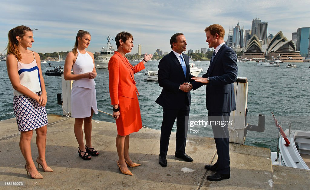 Prince Harry (R) is greeted by Australian Prime Minister Tony Abbott (2nd R) his wife Margie (3rd L) and daughters Bridget (L) and Francis (R) at the steps to Kirribilli House on October 5, 2013 in Sydney, Australia. Over 50 ships participate in the International Fleet Review at Sydney Harbour to commemorate the 100 year anniversary of the Royal Australian Navy's fleet arriving into Sydney. Prince Harry is an official guest of the Australian Government and will take part in the fleet review during his two-day visit to Australia.