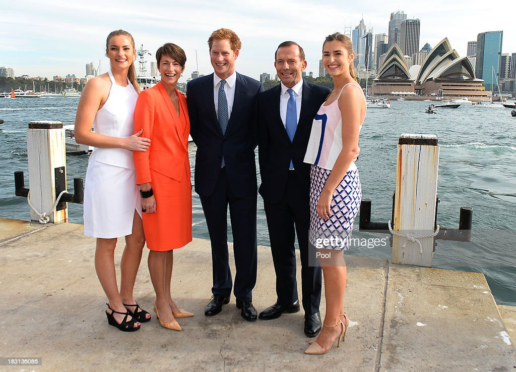 Prince Harry (C) is greeted by Australian Prime Minister Tony Abbott (2nd R) his wife Margie (2nd L) and daughters Bridget (L) and Francis (R) at the steps to Kirribilli House on October 5, 2013 in Sydney, Australia. Over 50 ships participate in the International Fleet Review at Sydney Harbour to commemorate the 100 year anniversary of the Royal Australian Navy's fleet arriving into Sydney. Prince Harry is an official guest of the Australian Government and will take part in the fleet review during his two-day visit to Australia.