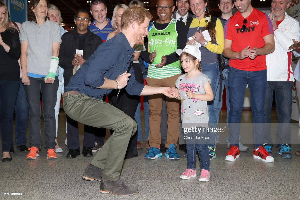 Prince Harry is helped by Melissa Howse to officially open the Virgin Money London Marathon Expo at ExCel on April 19, 2017 in London, England. Prince Harry, who is Patron of the London Marathon Charitable Trust, will meet runners and hand out race numbers, along with special edition 'Heads Together' headbands, which is the official Charity of the Year for this year's marathon.