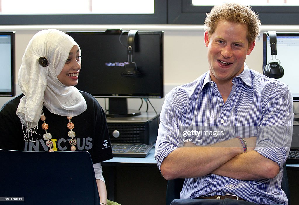 <a gi-track='captionPersonalityLinkClicked' href=/galleries/search?phrase=Prince+Harry&family=editorial&specificpeople=178173 ng-click='$event.stopPropagation()'>Prince Harry</a> (R) is pictured during a visit to Bethnal Green Academy where he joined a group of 60 students from schools across east London who will be receiving training to become digital media champions for the Invictus Games on July 21, 2014 in London, England. The Invictus Games is an international sports event for wounded warriors launched by <a gi-track='captionPersonalityLinkClicked' href=/galleries/search?phrase=Prince+Harry&family=editorial&specificpeople=178173 ng-click='$event.stopPropagation()'>Prince Harry</a> which is coming to London from 10-14 September 2014.