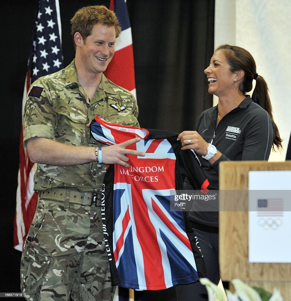 <a gi-track='captionPersonalityLinkClicked' href=/galleries/search?phrase=Prince+Harry&family=editorial&specificpeople=178173 ng-click='$event.stopPropagation()'>Prince Harry</a> is presented a t-shirt with <a gi-track='captionPersonalityLinkClicked' href=/galleries/search?phrase=Misty+May-Treanor&family=editorial&specificpeople=162762 ng-click='$event.stopPropagation()'>Misty May-Treanor</a> at a reception and brunch at the start of the 2013 Warrior Games at the U.S. Olympic Training Center on May 11, 2013 in Colorado Springs, Colorado. HRH will be undertaking engagements on behalf of charities with which the Prince is closely associated on behalf also of HM Government, with a central theme of supporting injured service personnel from the UK and US forces.
