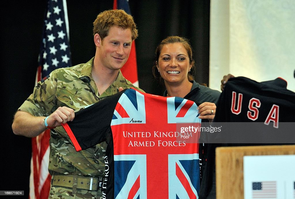 Prince Harry is presented a t-shirt with Misty May-Treanor at a reception and brunch at the start of the 2013 Warrior Games at the U.S. Olympic Training Center on May 11, 2013 in Colorado Springs, Colorado. HRH will be undertaking engagements on behalf of charities with which the Prince is closely associated on behalf also of HM Government, with a central theme of supporting injured service personnel from the UK and US forces.