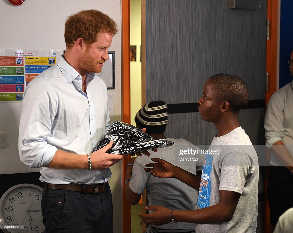 <a gi-track='captionPersonalityLinkClicked' href=/galleries/search?phrase=Prince+Harry&family=editorial&specificpeople=178173 ng-click='$event.stopPropagation()'>Prince Harry</a> is presented with a gift by 16 year-old Relebohile 'Mutsu' Potsane (who <a gi-track='captionPersonalityLinkClicked' href=/galleries/search?phrase=Prince+Harry&family=editorial&specificpeople=178173 ng-click='$event.stopPropagation()'>Prince Harry</a> has stayed in touch with since they first met during his first visit to Lesotho in 2004) who sang as part of the Basotho Youth Choir during their rehearsals at the Brit School on June 27, 2016 in London, England. The Basotho Youth Choir will perform alongside Sentebale Ambassador Joss Stone at tomorrow's Sentebale Concert at Kensington Palace, headlined by Coldplay. The choir members have all been supported by Sentebale's Secondary School Bursaries Progamme or Care for Vulnerable Children Programme. The Bursaries Programme covers the cost of school fees, uniforms and books for some of Lesotho's most disadvantaged children.