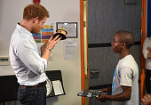 Prince Harry is presented with a gift by 16 yearold Relebohile 'Mutsu' Potsane who sang as part of the Basotho Youth Choir during their rehearsals at...