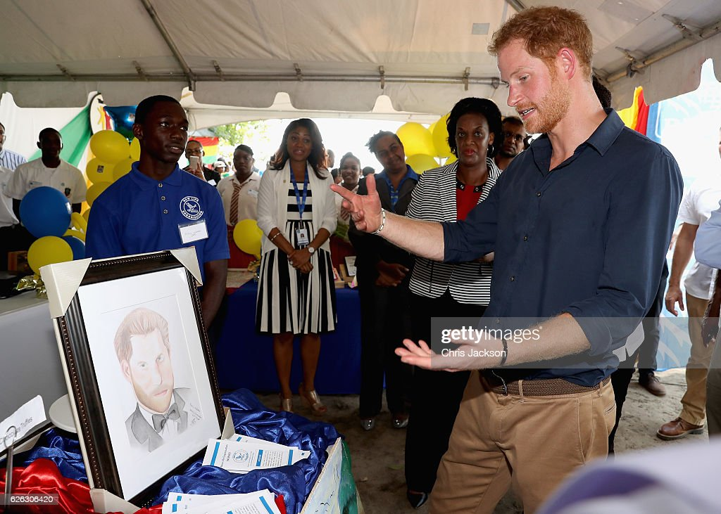 Prince Harry is presented with a portrait as he visits mangrove restoration projects on Grand Anse Beach ahead of visiting the coral reef on the ninth day of an official visit to the Caribbean on November 28, 2016 in St Georges, Grenada. Prince Harry's visit to The Caribbean marks the 35th Anniversary of Independence in Antigua and Barbuda and the 50th Anniversary of Independence in Barbados and Guyana.
