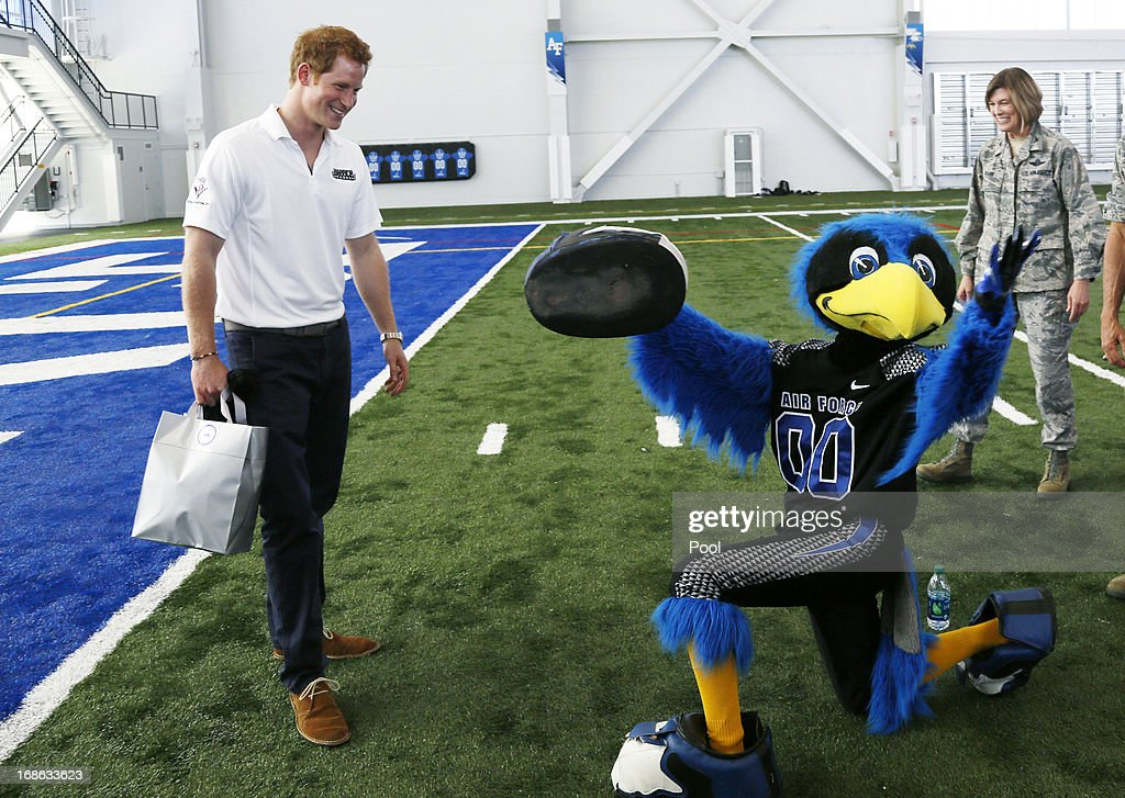 HRH <a gi-track='captionPersonalityLinkClicked' href=/galleries/search?phrase=Prince+Harry&family=editorial&specificpeople=178173 ng-click='$event.stopPropagation()'>Prince Harry</a> is presented with a shoe as a gift from the United States Air Force Academy's mascot 'The Bird' at the United States Air Force Academy's football training center during the fourth day of his visit to the United States on May 12, 2013 in Colorado Springs, Colorado. HRH will be undertaking engagements on behalf of charities with which the Prince is closely associated on behalf also of HM Government, with a central theme of supporting injured service personnel from the UK and US forces.