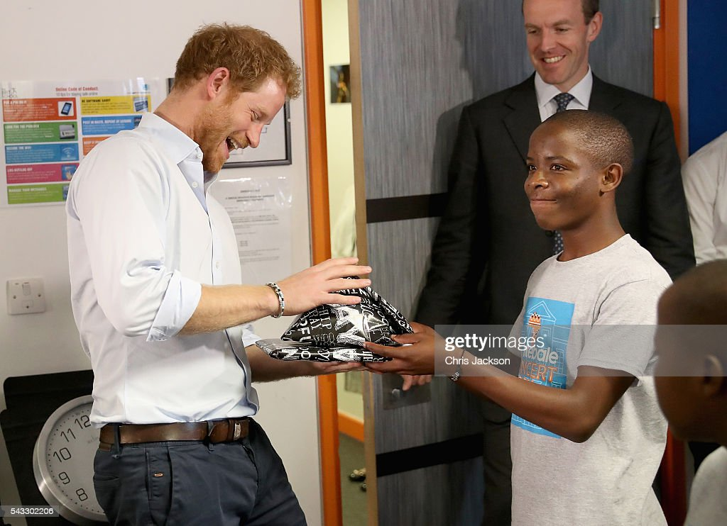 <a gi-track='captionPersonalityLinkClicked' href=/galleries/search?phrase=Prince+Harry&family=editorial&specificpeople=178173 ng-click='$event.stopPropagation()'>Prince Harry</a> is presented with gifts by 16 year-old Relebohile 'Mutsu' Potsane ( who <a gi-track='captionPersonalityLinkClicked' href=/galleries/search?phrase=Prince+Harry&family=editorial&specificpeople=178173 ng-click='$event.stopPropagation()'>Prince Harry</a> has stayed in touch with since they first met during his first visit to Lesotho in 2004) who is singing as part of the Basotho Youth Choir, made up of six boys and six girls, aged between 7 and 19 years old at the Brit School on June 27, 2016 in London, England. The Basotho Youth Choir will perform alongside Sentebale Ambassador Joss Stone at tomorrow's Sentebale Concert at Kensington Palace, headlined by Coldplay.