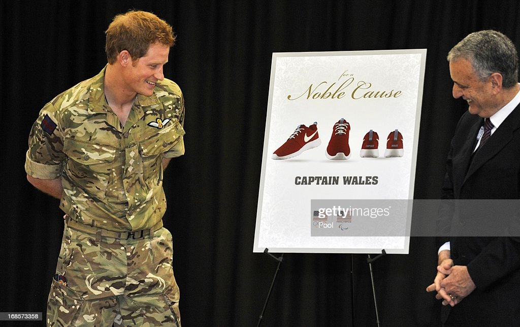 <a gi-track='captionPersonalityLinkClicked' href=/galleries/search?phrase=Prince+Harry&family=editorial&specificpeople=178173 ng-click='$event.stopPropagation()'>Prince Harry</a> is presented with personalised Nike trainers at a reception and brunch at the start of the 2013 Warrior Games at the U.S. Olympic Training Center on May 11, 2013 in Colorado Springs, Colorado. HRH will be undertaking engagements on behalf of charities with which the Prince is closely associated on behalf also of HM Government, with a central theme of supporting injured service personnel from the UK and US forces.