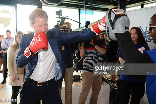 Prince Harry is seen boxing with Duke McKenzie at Queen Elizabeth Olympic Park during the launch of the Heads Together campaign on mental health on...
